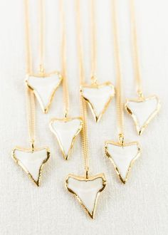 Mano Kihikihi necklace gold shark tooth. Odd, but cute.