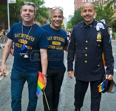 FOR THE LOVE OF UNIFORMS (Gay Pride Parade)   NEW YORK -  JUNE 26 : An unidentified three gay police officers..