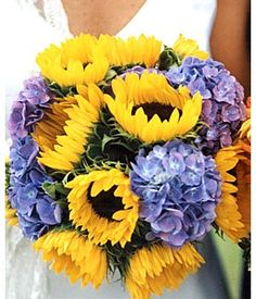 my two favorite flowers....sunflowers and blue hydrangea...what a beautiful bouquet!!!