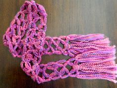 @Rachel Hurd - You want more scarves?  Here ya go - you just tie knots to make this scarf and others like it.  You pick the yarn and go on with your bad self, baby girl.