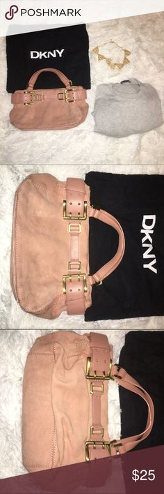 DKNY Bag A perfect bag for a night out! Pair it with your favorite pair of skinny jeans, a silky blouse, and high boots. Your new go-to bag! Gently used. New condition. DKNY Bags Mini Bags