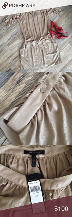 NEW BCBGMAXAZRIA shimmery taupe ruched dress Drop waist, blousy front pockets, beautiful pleating all along the top of collar and sleeves as well as the waist line. Lightweight fabric is 100% polyester and fully lined but there's no stretch and I'd say it fits true to size. I am usually a S in this brand and can get away with and XS sometimes (if it has spandex) because it usually runs large, but this one was too snug on me. I love a neutral colored dress with brightly colored heels…