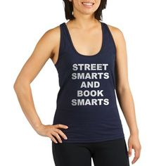 Women's dark color navy blue racerback tank top with Street Smarts And Book Smarts theme. In most cases the average person either has street smarts or book smarts. When someone has both they have an advantage in society. Available in black, navy blue, teal green, poppy red; x-small, small, medium, large for only $22.99. Go to the link to purchase the product and to see other options – http://www.cafepress.com/stsmarts