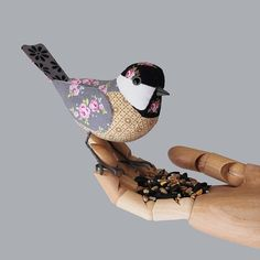 This little bird isn't embroidered, but its still a wonderful fabric creation!