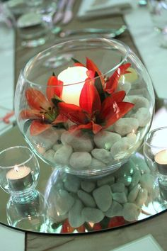 Red flowers and pebbles in fishbowl