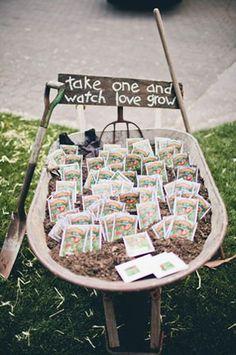 seed wedding favors in dirt filled wheelbarrow