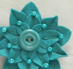 Turquoise on Turquoise Felt Flower Pin with Vintage Button, Hand embroidery and Matching Pearl Beads dorothydesigns: Felt Diy, Felt Crafts, Fabric Crafts, Sewing Crafts, Fabric Brooch, Felt Brooch, Felt Flowers, Fabric Flowers, Felt Embroidery