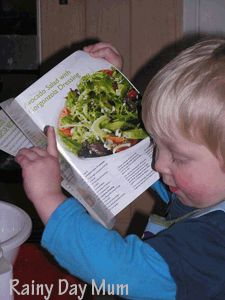 Pretend cooking with real ingredients and a recipe book ideal play for toddlers