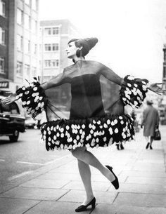 Ann Milling models an organza cocktail dress by Dior, London, 1967.