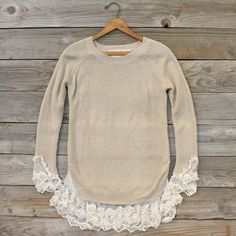 Pretty lace details...also a great DIY to add lace to a sweater