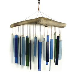 Blue & Green Glass Wind Chime is handcrafted by artisans in Bali. Using sandblasted glass and driftwood or other found wood, each one is an original. Glass