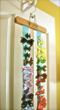 Life as a Thrifter: Hair Bow Hanger {but will use for all my flower pins… Baby Crafts, Crafts For Kids, Hair Bow Hanger, Hair Clip Organizer, Hair Accessories Holder, Pant Hangers, Clothes Hanger, Diy Hair Bows, Cute Bows