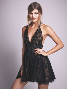 Halter Mini Dress | American made crochet halter dress with V-neckline in a fit-and-flare silhouette. Straps can be tied, twisted or knotted to alter style of wear. Features a low, open back, voluminous skirt and full contrast lining.