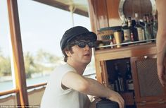 Candid: John Lennon pictured in a bar in Miami, Florida during the Beatles 1964 tour of the US