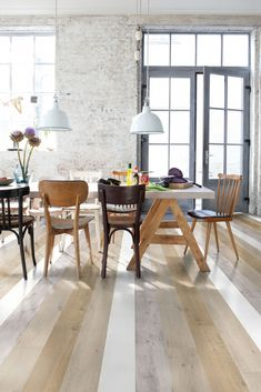 How to design a kitchen: rustic, contemporary feeling space with wooden flooring and mismatching dining furniture by Quickstep Impressive Laminate