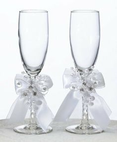 """Pearl Garden Glasses, Silver by All Theme Weddings. $30.52. This pair of toasting glasses measures 8"""" tall.Each glass is decorated with a white satin and sheer bow, as well as a silver decoration of wire, pearls and rhinestones.Decoration is removable."""