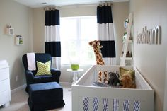 Love these horizontal stripes drapes in this #babyboy #nursery!