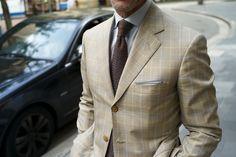Nice jacket.  Nice tie.  Nice car.