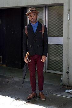 Shop this look on Lookastic:  http://lookastic.com/men/looks/hat-longsleeve-shirt-pocket-square-backpack-blazer-chinos-socks-derby-shoes/4686  — Brown Wool Hat  — Blue Long Sleeve Shirt  — Burgundy Polka Dot Pocket Square  — Brown Leather Backpack  — Black Cotton Blazer  — Burgundy Chinos  — Grey Socks  — Brown Leather Derby Shoes