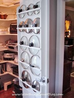 Now this one I like !  If you're handy, try building a flat rack into a pantry or closet door. The slim design that lids require won't add much bulk. See more at Worthing Court »  - GoodHousekeeping.com