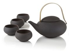 Pebble teapot set I recently fell in love with the no handle tea cups I think this one is very modern