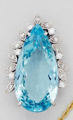 Aquamarine and Diamond Pendant  Set with a pear-shaped aquamarine weighing approximately 20.50 carats, accented with round diamonds, with gold plated chain