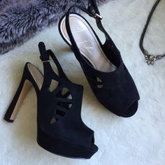 Black high heels Platform black suede heels with cutouts and straps. Super comfortable and in good condition. Only worn once. Has some slight scuffs as pictured on the right shoe. Marc Fisher Shoes Heels