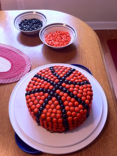 easy basketball cake! This was for my niece who doesn't like peanut butter so instead of reeses pieces I used orange and black m&ms (less than 1 bag of black and less than 1 and1/2 bags of orange found at Party City). Drew the lines in the icing and started with the black m&ms and filled in with the orange.