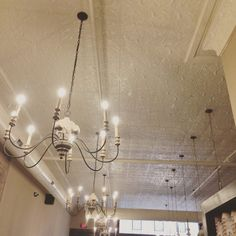 Fort Scott Common Ground coffee shop with a beautiful ceiling! #tinceiling #tinceilings  Common Grounds Coffee, Fort Scott, Tin Ceilings, Ground Coffee, Art Deco Fashion, Home Remodeling, Coffee Shop, Chandelier, Victorian