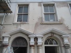 White marble Jesmonite, capitals and pediments fitted on site in Berwick upon Tweed.