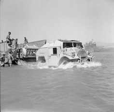 A Chevrolet FAT (Field Artillery Tractor) and 25-pdr field gun disembark from a tank landing craft during a large scale invasion exercise in the Gulf of Aqaba, 22 June 1943.