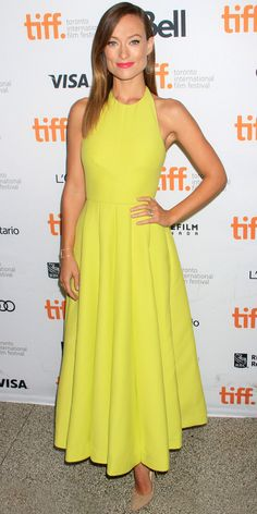 Olivia Wilde stood out at the Toronto International Film Festival in a bold chartreuse Valentino halter dress. Jimmy Choo heels and a salmon pink lip finished the look.