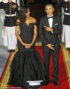 President Barack Obama remarks at how good his wife first lady Michelle Obama looks...
