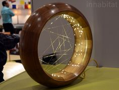 Kalin-Asenov Accretion Lamp is a walnut ring that contains constellations of LED lights along its inner rim.