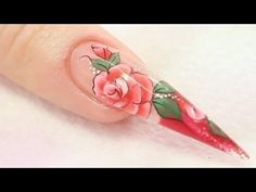 Gemma Lambert and naio.co.uk - Rose Acrylic Nail Design - Video Tutorial - Treat yourself to a bouquet of roses with this fantastic acrylic nail design. In this tutorial Video Gemma Lambert show us how to create a visually stunning stiletto nail with a vibrantred rose design.  www.naio.co.uk and youtube/naiouk