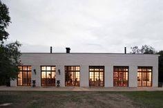 Commercial restaurant exterior, white painted brick facade.