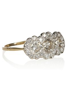 Hailing from the 1940s when classic elegance reigned supreme, Heirlooms' vintage 18-karat ring is a statement in sophisticated glamour. This sparkling piece is clustered with 1.30-carat white diamonds in a floral motif, making it a beautifully feminine investment for your jewelry box. A style this stunning should be worn solo or alongside a delicate bracelet for the most refined finish.