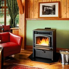 High-efficiency pellet stoves let you turn down the household thermostat while warming your rooms, providing ambience, and reducing your energy bills. | thisoldhouse.com