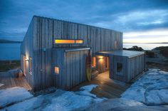 the modest-sized dwelling by TYIN tegnestue architects sits by the ocean, the building itselt reflecting the traditional cultures of norway.