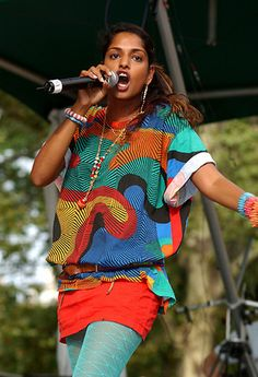 Indigenous prints from the top end of Australia on M.I.A's retro 80s stage look
