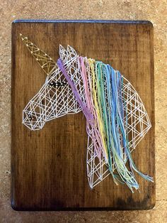 Handmade unicorn string art. Great for hanging or freestanding. I can add sawtooth hanging hardware upon request. Check out my store for other string art pieces! I can make custom designed string art pieces upon request. Just let me know what you are interested in! Contact for pricing or any additional questions. Thank you for looking! etsy.com/shop/shopbyamber I can sell locally if within the St. Charles/St. Louis area to save shipping cost.