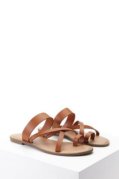 A pair of sandals featuring a strappy crisscross design and a toe ring crafted from faux leather.