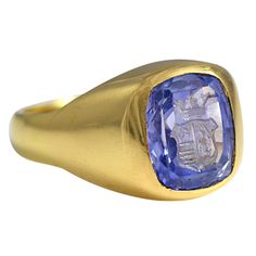 A Cornflower Sapphire Intaglio Signet Ring | From a unique collection of vintage signet rings at http://www.1stdibs.com/jewelry/rings/signet-rings/
