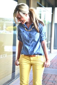 Colored jeans and a denim shirt.