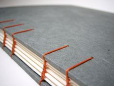Slate Gray Sketch Book / Guest Book - Coptic Stitch Binding, Gray and Orange, Hand Bound Book, Made to Order. $65.00, via Etsy.