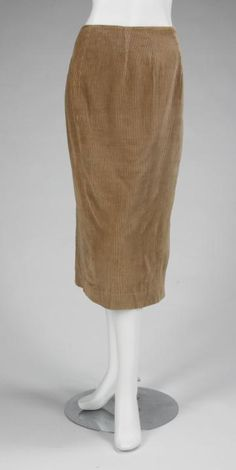 "A tan corduroy skirt owned by Marilyn Monroe. Label reads ""designed by Jax."" Straight shape with side zipper and back kick pleat. No size present. PROVENANCE Lot 30, ""Property From the Estate of Marilyn Monroe,"" Julien's Auctions, Los Angeles, June 4, 2005. Marilyn wore this skirt on a trip to Washington DC in support of Arthur Miller during his trial, 16 April 1957."