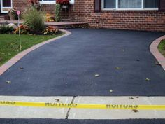 Key Maintenance Tips to Keep Your Asphalt or Concrete Driveway Mighty
