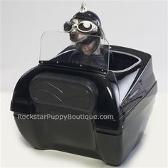 This hard shell motorcycle pet carrier has a windshield and mounts securely onto the luggage rack of a motorcycle. All mounting hardware is included.