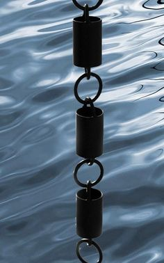 Channel link rain chain in flat black powder coated aluminum to replace your downspouts.