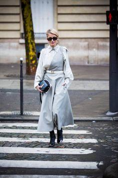Caroline Daur wearing Nina Ricci white and grey dress and Nina Ricci white belt is seen in the streets of Paris before the Nina Ricci show during...